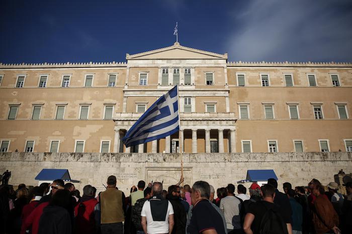 Atene vota misure. Eurogruppo decide su nodi Grecia (ANSA/AP Photo/Yorgos Karahalis)