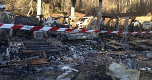 I resti dei camper e delle roulotte presenti nel parcheggio che li ospitava  in zona Paù, a Luino