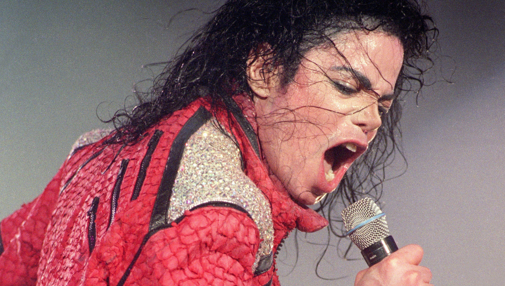Michael Jackson performs live on stage, 1996. (Photo by Phil Dent/Redferns)